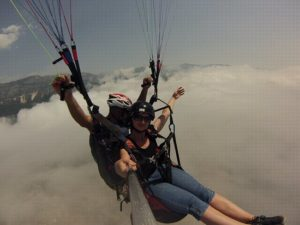 paragliding budva flying above the clouds