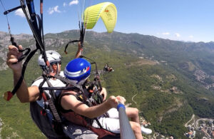 with Paragliding Budva tandem flight we have time to take pictures, or make a video, and simply enjoy the amazing scenery; sea, mountains, sky, sun! When we prepare to land, all the passenger needs to do is stand up