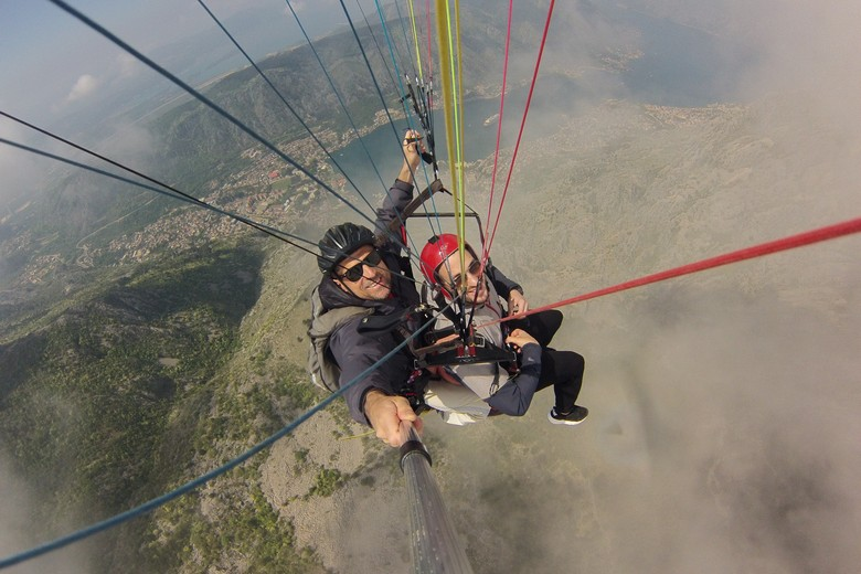 Paragliding montenegro budva offer unique feeling that we can catch with.high-resolution photos and videos of your tandem paragliding flight you will get on your hand sd card or you will get on your e-mail