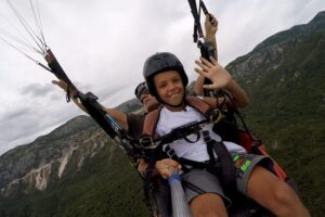 Paragliding Montenegro offer unforgettable adventure activity also for youngest tourists.